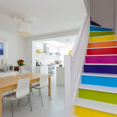 Trendy painted l-shaped staircase photo in London with painted risers