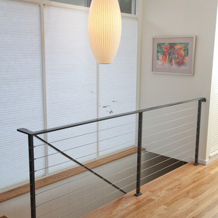 Inspiration for a small midcentury wood straight staircase in Seattle with wood risers.