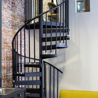 Small modern metal spiral staircase in Birmingham with metal risers.
