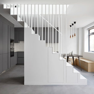 Photo of a contemporary straight metal railing staircase in London.