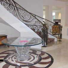 Eclectic Staircase by Cornerstone Constructors, LLC