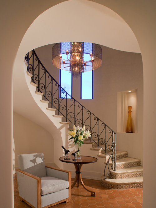 Example Of A Tuscan Travertine Metal Railing Staircase Design In Miami
