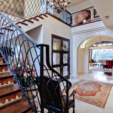 Mediterranean Staircase by Michael Molthan Luxury Homes Interior Design Group
