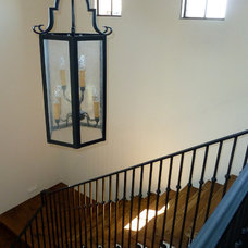Mediterranean Staircase by Pentimento Lighting and Furnishings