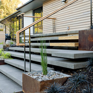 Example of a midcentury modern concrete floating staircase design in Portland