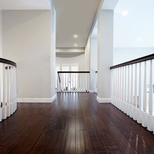 Inspiration for a large 1950s painted curved staircase remodel in Los Angeles with painted risers