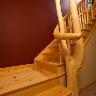 Inspiration for a wood l-shaped staircase in Toronto with wood risers.