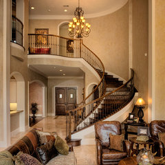 traditional staircase by Frankel Building Group