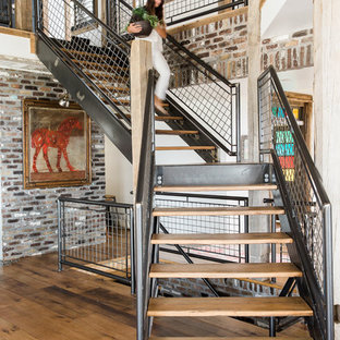 Mountain style wooden l-shaped open and metal railing staircase photo in Salt Lake City