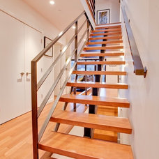 Contemporary Staircase by Architrix Design Studio Inc.