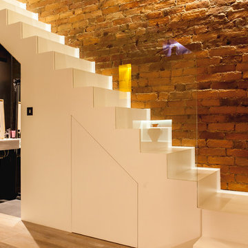 Minimalist staircase with hidden under-stair cloakroom
