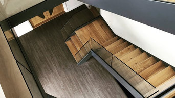 Minimilistic Channelled Stringer Staircase with Frameless Glass