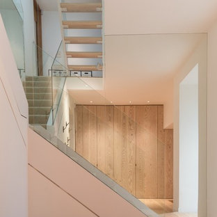 Example of a mid-sized trendy wooden l-shaped open staircase design in London