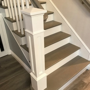 Mid-sized arts and crafts painted l-shaped wood railing staircase photo in Orange County with painted risers