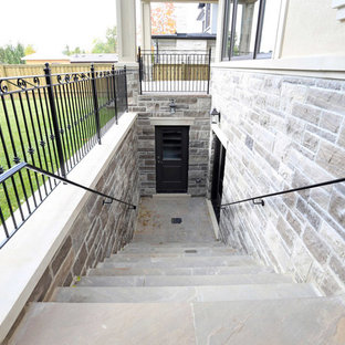 Staircase - large traditional concrete straight staircase idea in Toronto with concrete risers