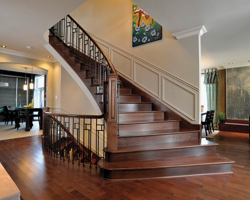 Example Of A Trendy Staircase Design In Montreal