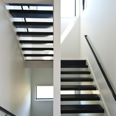 Modern Staircase by Troxel Custom Homes