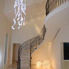 Contemporary Staircase by CLAUDIA LUJAN
