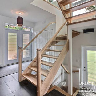 Inspiration for a contemporary wooden u-shaped staircase remodel in Miami with wooden risers