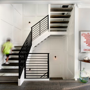 Country wooden u-shaped open and metal railing staircase photo in Chicago