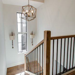 Example of a mid-sized cottage wooden u-shaped staircase design in Chicago with painted risers