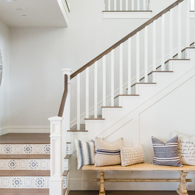 Staircase - coastal wooden l-shaped wood railing staircase idea in San Diego with tile risers