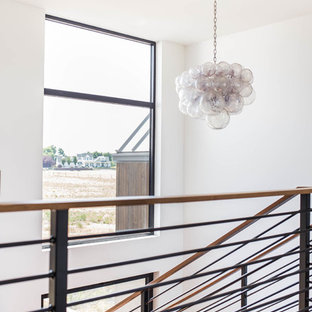 Inspiration for a large modern wooden u-shaped mixed material railing staircase remodel in Seattle with wooden risers
