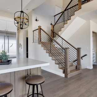 Inspiration for a country wooden u-shaped mixed material railing staircase remodel in Salt Lake City with wooden risers