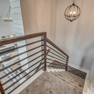 Inspiration for a large country carpeted u-shaped metal railing and shiplap wall staircase remodel with carpeted risers