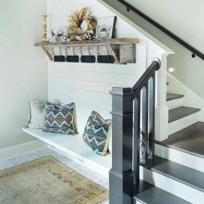 Mid-sized country painted l-shaped staircase photo in Nashville with painted risers