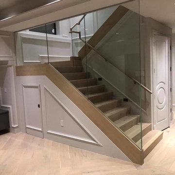 Modern Glass Panel Staircase - White Wainscoting