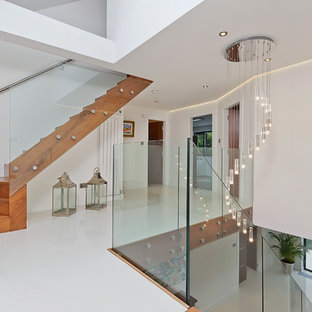 Contemporary glass railing staircase in Sussex.