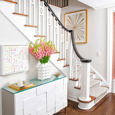 Mid-sized transitional carpeted l-shaped wood railing staircase photo in New York with carpeted risers