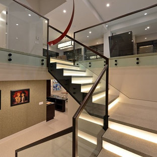 Staircase - large contemporary l-shaped metal railing staircase idea in Austin with glass risers