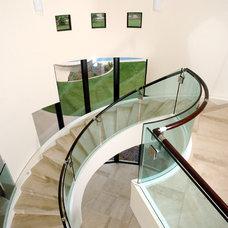 Modern Staircase by Steigerwald-Dougherty, Inc.