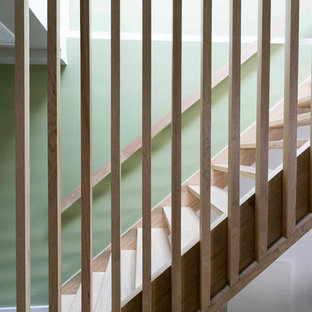 Staircase - mid-sized modern wooden straight open and wood railing staircase idea in New York