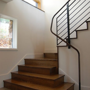 Inspiration for a contemporary wooden staircase remodel in Charlotte with wooden risers