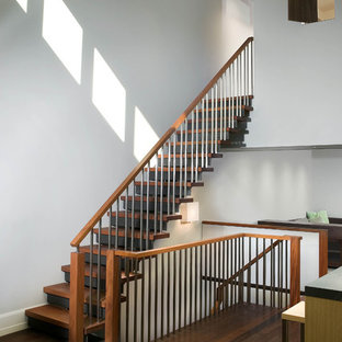 Inspiration for a contemporary wooden straight mixed material railing staircase remodel in New York