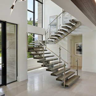 Inspiration for a contemporary u-shaped open and glass railing staircase remodel in Miami