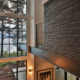 Example of a large minimalist wooden straight open and mixed material railing staircase design in Seattle