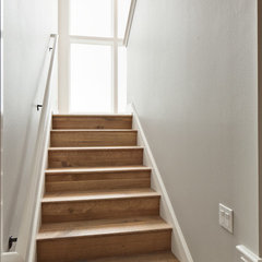 traditional staircase by Stuart Sampley Architect