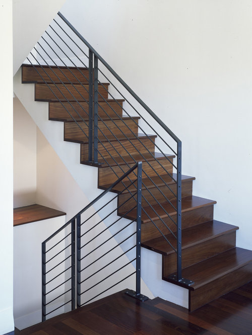 Example Of A Minimalist Wooden Staircase Design In San Francisco