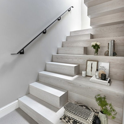 Staircase - mid-sized contemporary wooden u-shaped metal railing staircase idea in Other with wooden risers