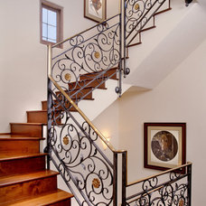 Mediterranean Staircase by Giffin & Crane General Contractors, Inc.