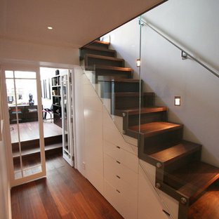 Example of a large trendy wooden u-shaped open staircase design in London