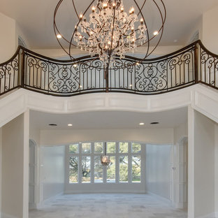 Large transitional carpeted curved metal railing staircase photo in Sacramento with carpeted risers