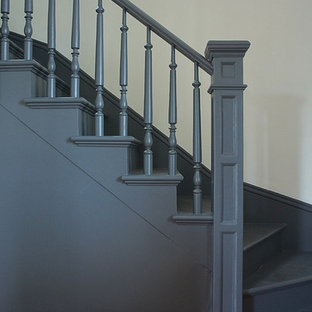 Staircase - mid-sized victorian painted l-shaped wood railing staircase idea in Portland with painted risers
