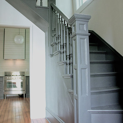 Example of a mid-sized cottage painted l-shaped wood railing staircase design in Portland with painted risers