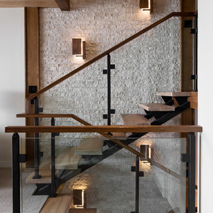 Staircase - contemporary wooden open and glass railing staircase idea in Burlington