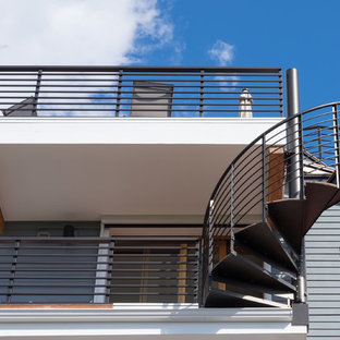 Mid-sized transitional metal spiral open staircase photo in Seattle